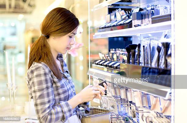 Asian woman shopping in the store cosmetics..