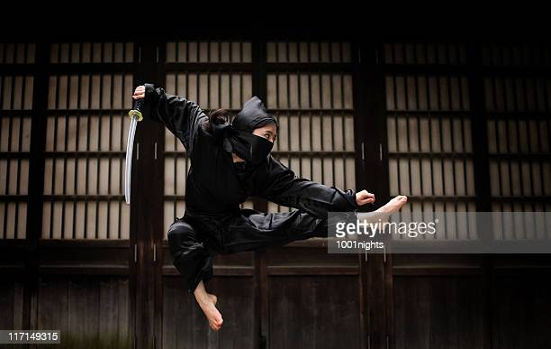 Asian woman showing her ninja moves