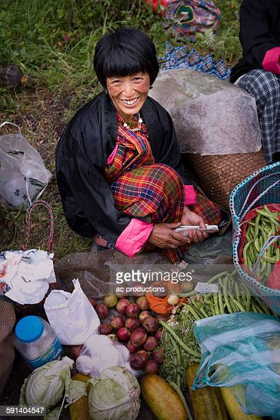 Asian woman smiling at market