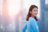 Asian woman smiling during sunset