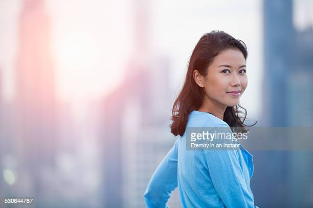 Asian woman smiling during sunset