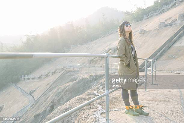 Asian woman thinking outdoor
