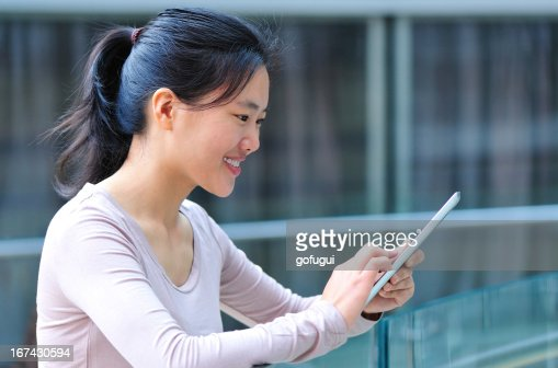 asian woman use tablet in modern shopping mall : Stock Photo