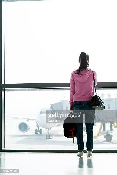 Asian woman waiting at the airport