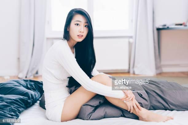 Asian Woman Waking Up