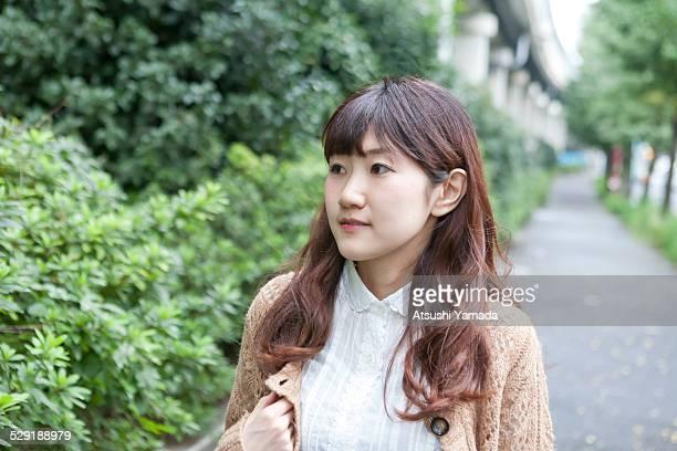 Asian woman walking on road