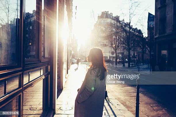Asian woman walking on street in dawn