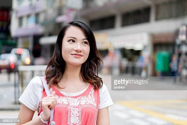 Asian woman walking on the street
