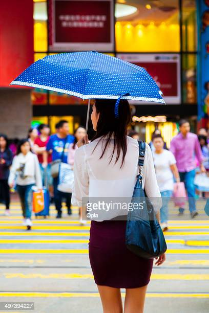 Asian woman with blue umbrella