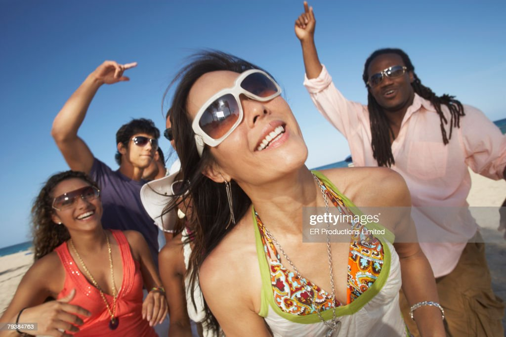 Asian woman with friends in background : Stock Photo