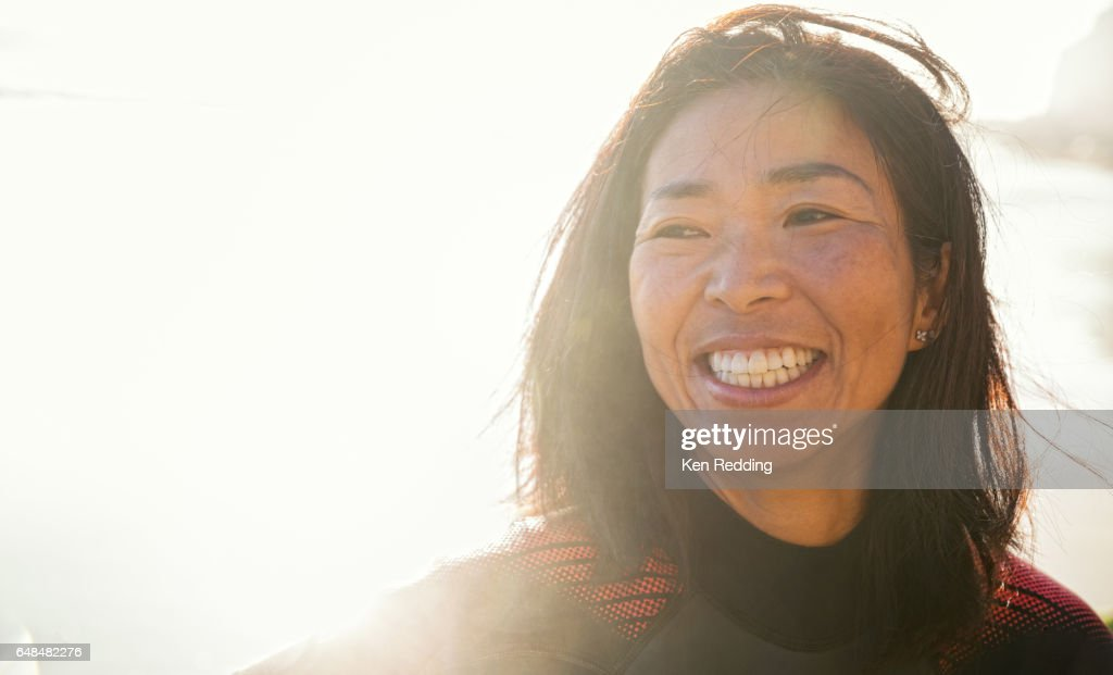 Asian Woman with Surfboard : ストックフォト