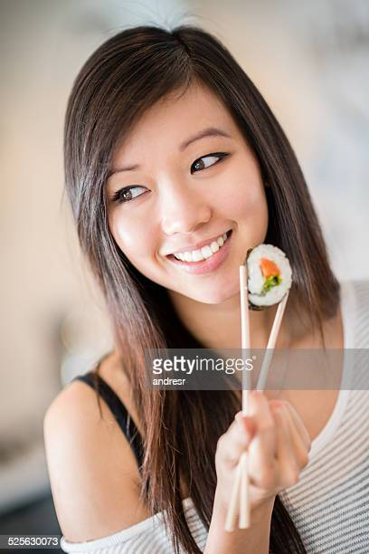 Asian woman with sushi