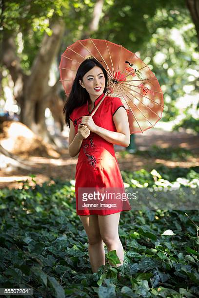Asian woman with traditional umbrella