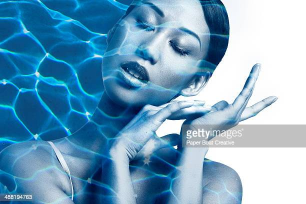 Asian woman with water ripples on her face