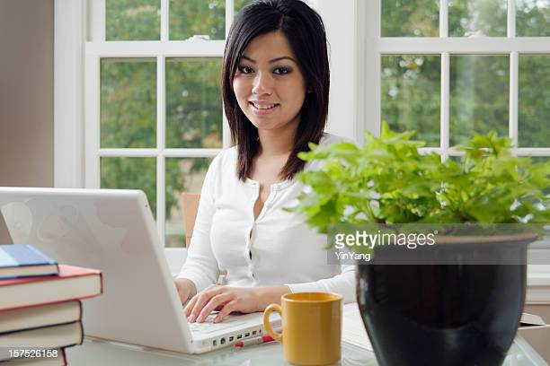 Asian Woman Working at Home on Laptop Computer, Telecommuting, Studying