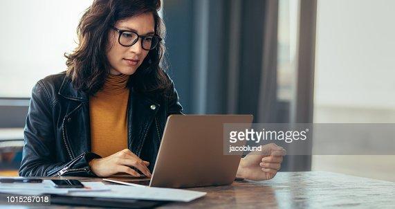 Asian woman working laptop at office : Foto de stock