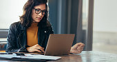 Asian woman working laptop. Business woman busy working on laptop computer at office.