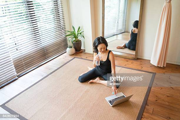 Asian woman working out at home