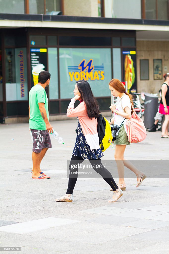 Asian women going to station Heidelberg : Stock Photo
