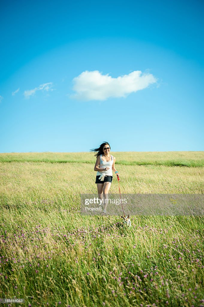 Asian Women running with Jack Russell Dog : Stock Photo