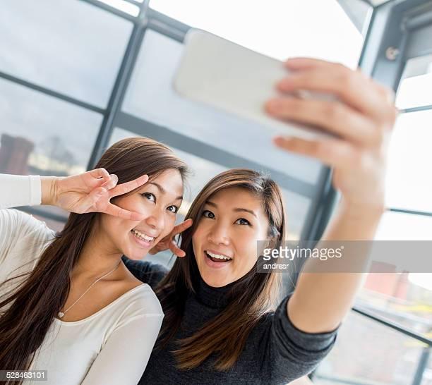 Asian women taking a selfie