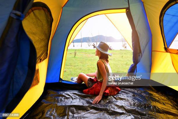 Asian women tourist , Sit inside the tent .Holiday , vacation , summer concept .