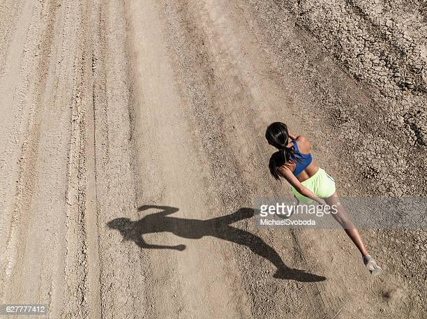 Asian Women With Prosthetic Leg Running In The Desert