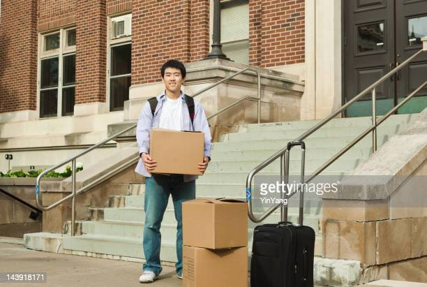 Asian Young Man Student Moving into University Campus Dormitory Entrance
