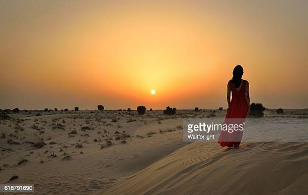 Asian young woman in desert