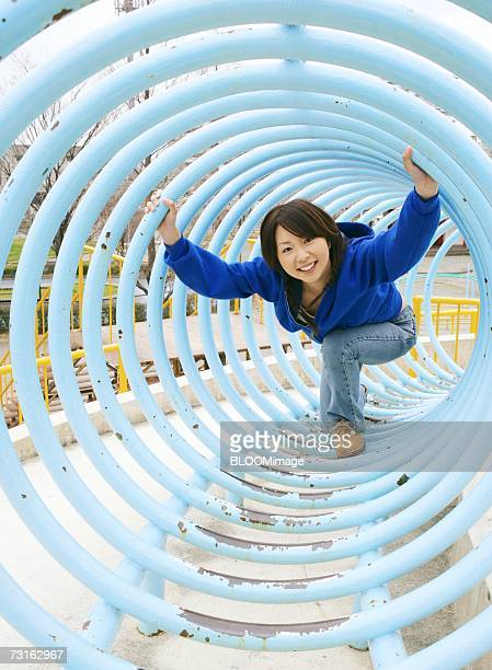 Asian young woman playing in a park