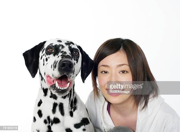 Asian young woman touching dog