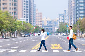 Asian youth in the city to cross the road