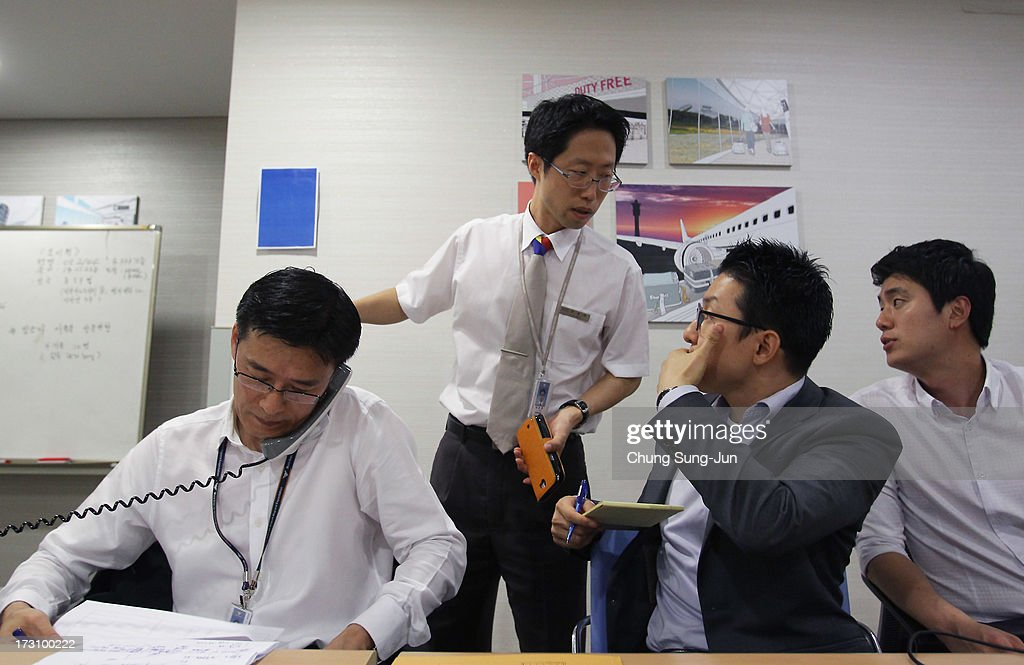 Asiana Airline employees talk on the phone with family members of passengers on Asiana Airlines Flight 214 which crashed as Asiana Airlines set up an emergancy room and phone line at the Incheon International Airport on July 7, 2013 in Incheon, South Korea. Two people are dead and more than 180 injured after an Asiana Airlines Boeing 777 aircraft coming from Seoul, South Korea crash-landed at San Francisco International Airport on July 6, 2013.