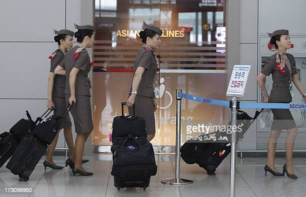 Asiana Airlines crew prepare to board their flight at the Incheon International Airport on July 7 2013 in Incheon South Korea Two people are dead and...