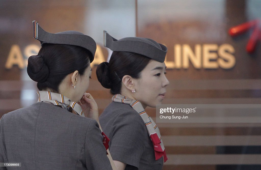 Asiana Airlines crew prepare to board their flight at the Incheon International Airport on July 7, 2013 in Incheon, South Korea. Two people are dead and more than 180 injured after an Asiana Airlines Boeing 777 aircraft coming from Seoul, South Korea crash-landed at San Francisco International Airport on July 6, 2013.