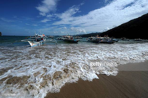 AsiaTourismEnvironmentPhilippinesFEATURE by Karl MalakunasThis photo taken on February 18 2011 shows boats on a beach in Puerto Princesa on the...