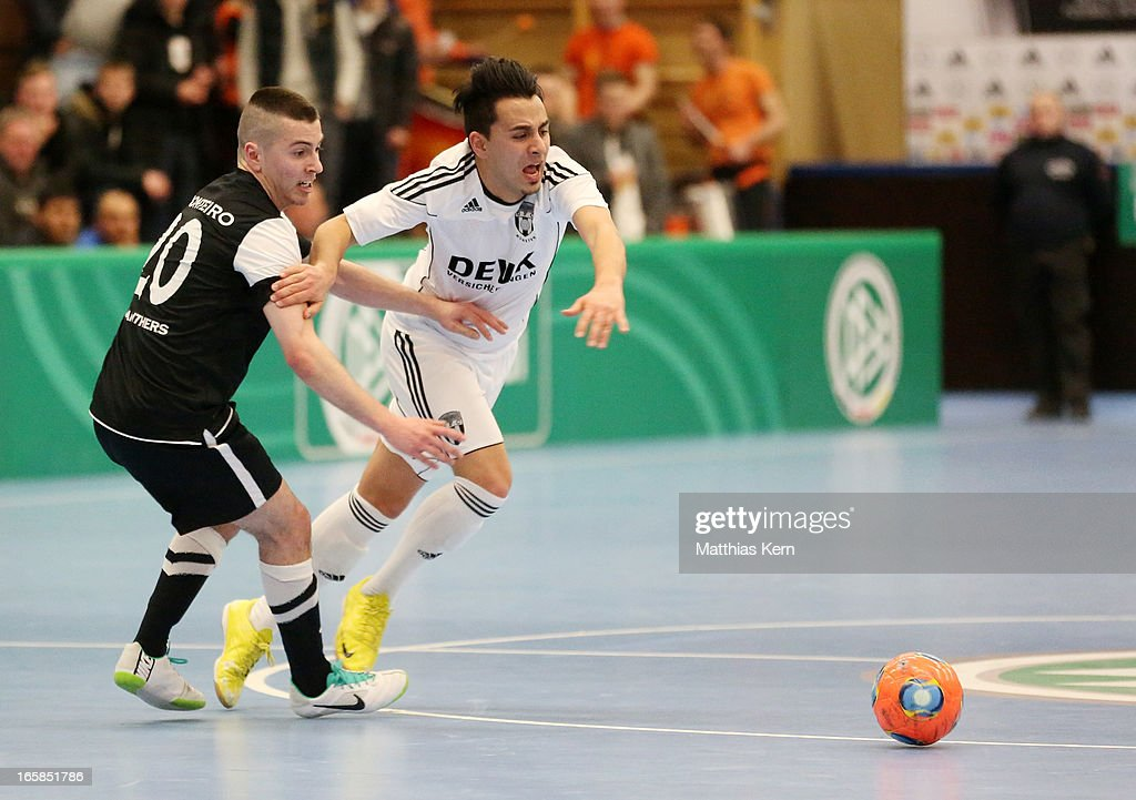 Asiel Massud Sarmie (R) of Muenster battles for the ball with Carlos Rafael Ferreira Monteiro (L) of Hamburg during the DFB Futsal Cup final match between Hamburg Panthers and UFC Muenster at Sporthalle Wandsbek on April 6, 2013 in Hamburg, Germany.