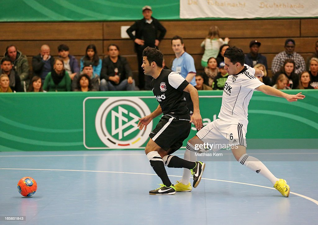 Asiel Massud Sarmie (R) of Muenster battles for the ball with Imad Mokaddem (L) of Hamburg during the DFB Futsal Cup final match between Hamburg Panthers and UFC Muenster at Sporthalle Wandsbek on April 6, 2013 in Hamburg, Germany.