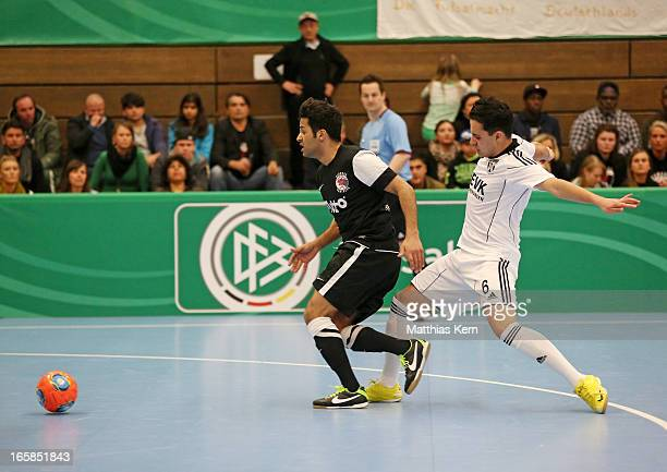 Asiel Massud Sarmie of Muenster battles for the ball with Imad Mokaddem of Hamburg during the DFB Futsal Cup final match between Hamburg Panthers and...