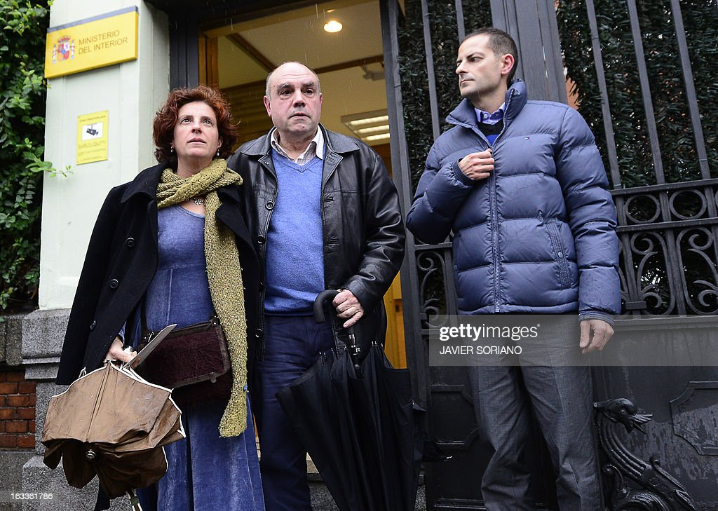 Asier Gonzalez (R) and Amaia Gonzalez (L), relatives of Yolanda Gonzalez, a student killed by members of a right-wing organization in 1980, and their friend Alejandro Arizkun (C) leave the Spanish Interior Ministry after a meeting in Madrid on March 8, 2013. On February 24, the Spanish newspaper El Pais revealed the new life of Emilio Moro Hellin, a former member of a commando linked to Spanish right-wing organization Fuerza Nueva who was sentenced in 1982 to 43 years in prison for the murder of Yolanda Gonzalez. Emilio Moro Hellin was released after serving 14 years in prison for the murder, he then changed his name for Luis Enrique Hellin and according to El Pais, worked as a legal expert for the Spanish Police. AFP PHOTO / JAVIER SORIANO