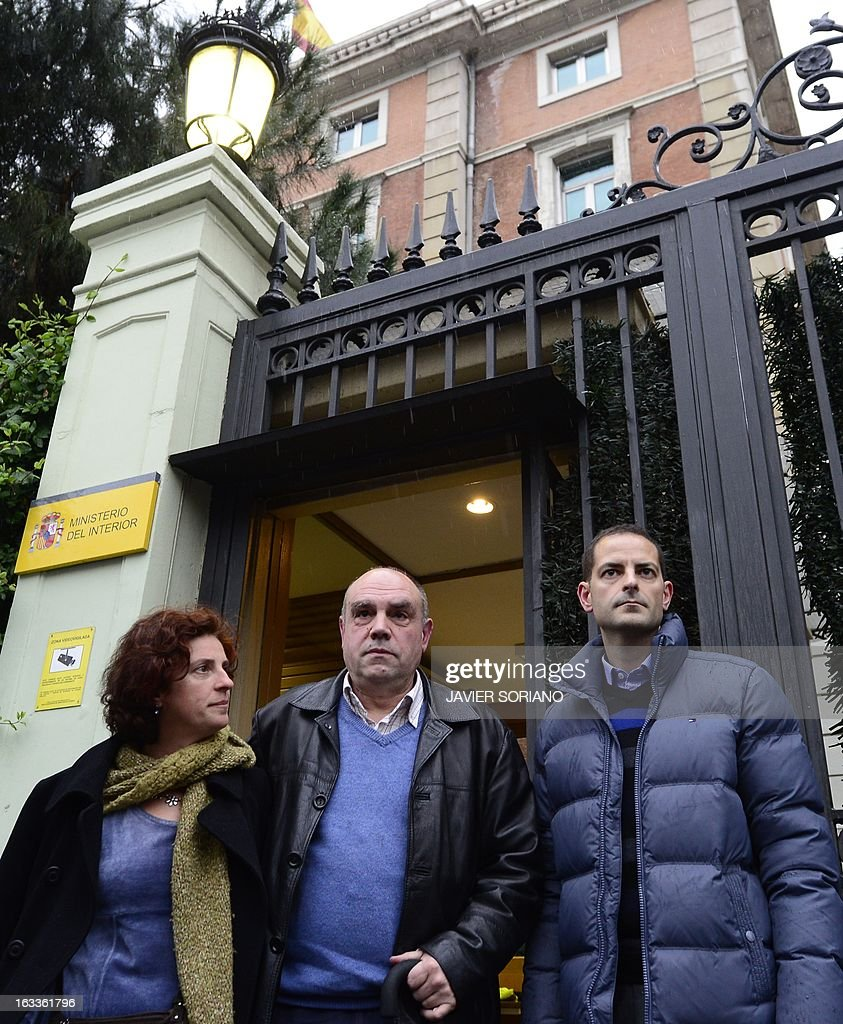 Asier Gonzalez (R) and Amaia Gonzalez (L), relatives of Yolanda Gonzalez, a student killed by members of a right-wing organization in 1980, and their friend Alejandro Arizkun (C) leave the Spanish Interior Ministry after a meeting in Madrid on March 8, 2013. On February 24, the Spanish newspaper El Pais revealed the new life of Emilio Moro Hellin, a former member of a commando linked to Spanish right-wing organization Fuerza Nueva who was sentenced in 1982 to 43 years in prison for the murder of Yolanda Gonzalez. Emilio Moro Hellin was released after serving 14 years in prison for the murder, he then changed his name for Luis Enrique Hellin and according to El Pais, worked as a legal expert for the Spanish Police.