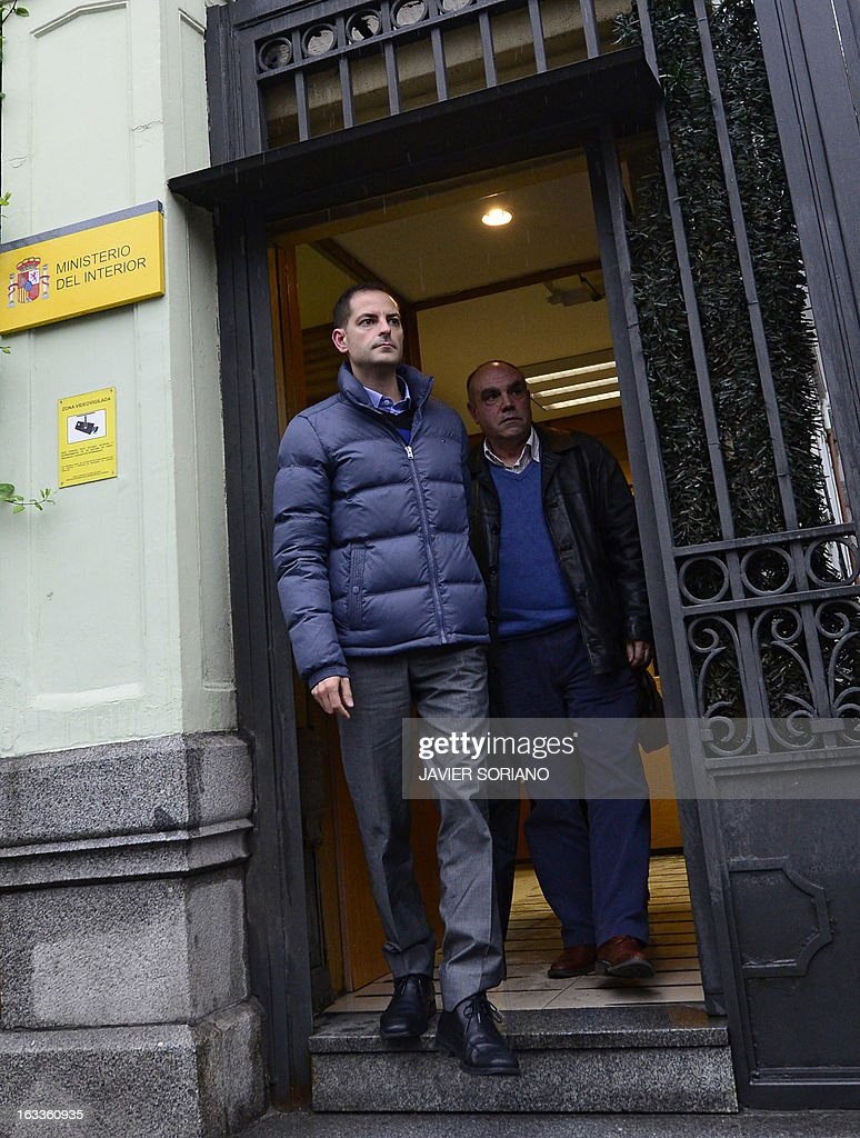 Asier Gonzalez (L), brother of Yolanda Gonzalez, a student killed by members of a right-wing organization in 1980, and Alejandro Arizkun (R) leave the Spanish Interior Ministry after a meeting in Madrid on March 8, 2013. On February 24, the Spanish newspaper El Pais revealed the new life of Emilio Moro Hellin, a former member of a commando linked to Spanish right-wing organization Fuerza Nueva who was sentenced in 1982 to 43 years in prison for the murder of Yolanda Gonzalez. Emilio Moro Hellin was released after serving 14 years in prison for the murder, he then changed his name for Luis Enrique Hellin and according to El Pais, worked as a legal expert for the Spanish Police.