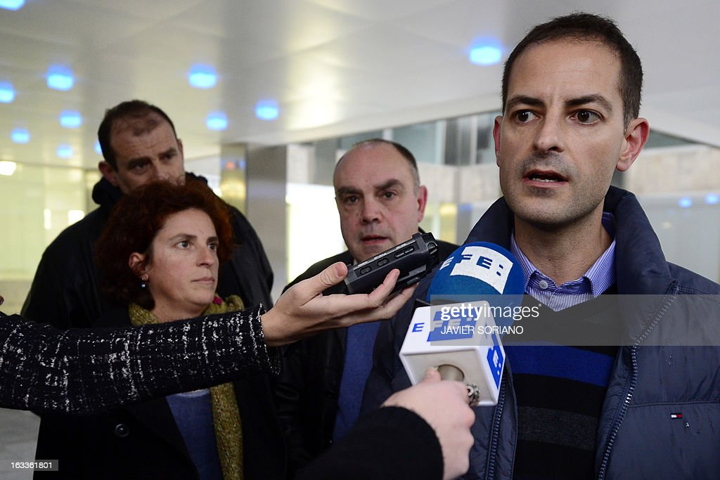 Asier Gonzalez (R), brother of Yolanda Gonzalez, a student killed by members of a right-wing organization in 1980, speaks to the press next to his sister Amaia Gonzalez (L) and their friend Alejandro Arizkun (C) after a meeting at the Spanish Interior Ministry in Madrid on March 8, 2013. On February 24, the Spanish newspaper El Pais revealed the new life of Emilio Moro Hellin, a former member of a commando linked to Spanish right-wing organization Fuerza Nueva who was sentenced in 1982 to 43 years in prison for the murder of Yolanda Gonzalez. Emilio Moro Hellin was released after serving 14 years in prison for the murder, he then changed his name for Luis Enrique Hellin and according to El Pais, worked as a legal expert for the Spanish Police.