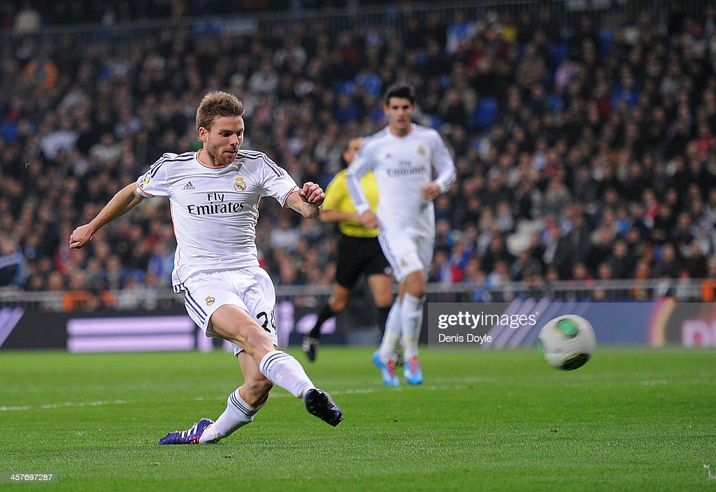 <a gi-track='captionPersonalityLinkClicked' href=/galleries/search?phrase=Asier+Illarramendi&family=editorial&specificpeople=9625979 ng-click='$event.stopPropagation()'>Asier Illarramendi</a> alias 'Illara' of Real Madrid scores Real's first goal during the Copa del Rey, Round of 32 2nd leg match between Real Madrid and Olimpic de Xativa at Santiago Bernabeu stadium on December 18, 2013 in Madrid, Spain.