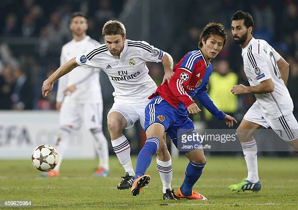 Asier Illarramendi of Real Madrid and Yoichiro Kakitani of FC Basel in action during the UEFA Champions League Group B match between FC Basel 1893...