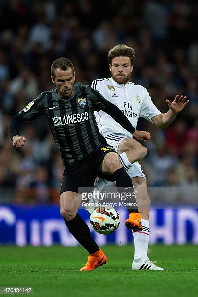 Asier Illarramendi of Real Madrid CF competes for the ball with Sergio Paulo Barbosa alias Duda of Malaga CF during the La Liga match between Real...