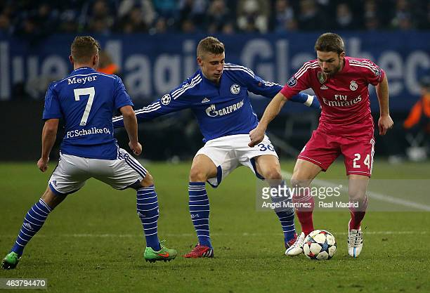 Asier Illarramendi of Real Madrid competes for the ball with Felix Platte of FC Schalke 04 during the UEFA Champions League Round of 16 first leg...
