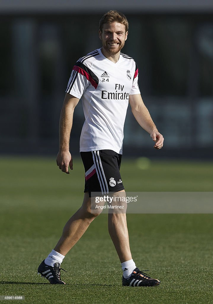 <a gi-track='captionPersonalityLinkClicked' href=/galleries/search?phrase=Asier+Illarramendi&family=editorial&specificpeople=9625979 ng-click='$event.stopPropagation()'>Asier Illarramendi</a> of Real Madrid smiles during a training session at Valdebebas training ground on November 24, 2014 in Madrid, Spain.