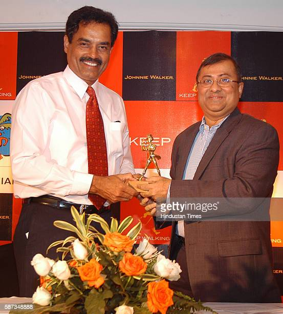 Asif Adil Managing Director of Diageo India felicitated Dilip Vengsarkar with the Johnnie Walker ' Keep Walking Award' at CCICK Naidu Hall
