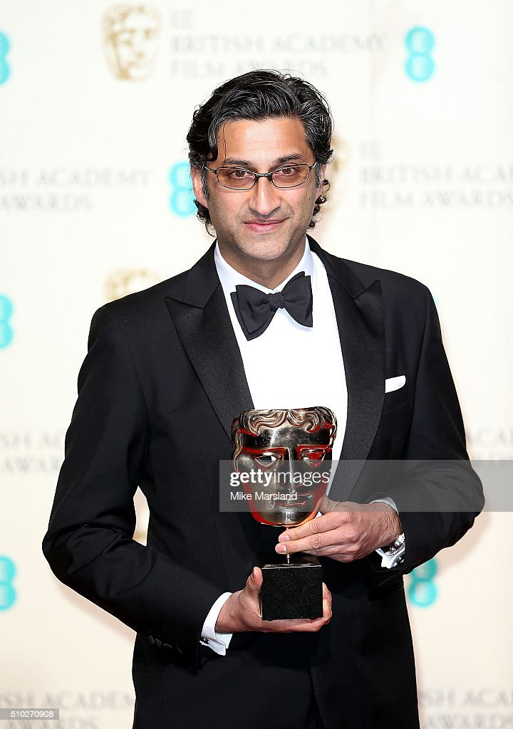 <a gi-track='captionPersonalityLinkClicked' href=/galleries/search?phrase=Asif+Kapadia&family=editorial&specificpeople=680084 ng-click='$event.stopPropagation()'>Asif Kapadia</a>, winner of Best Documentary for 'Amy', poses in the winners room at the EE British Academy Film Awards at The Royal Opera House on February 14, 2016 in London, England.
